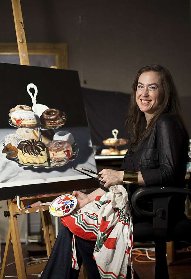 Amy Nelder sits for a portrait in her studio where she was working on a still life of doughnuts at Chloe Fine Arts Gallery in San Francisco, Calif., on Wednesday, September 21, 2011.  Nelder, a former police forensic artist, now works on still life paintings out of her gallery in Fisherman's Wharf. Photo: Laura Morton, Special To The Chronicle