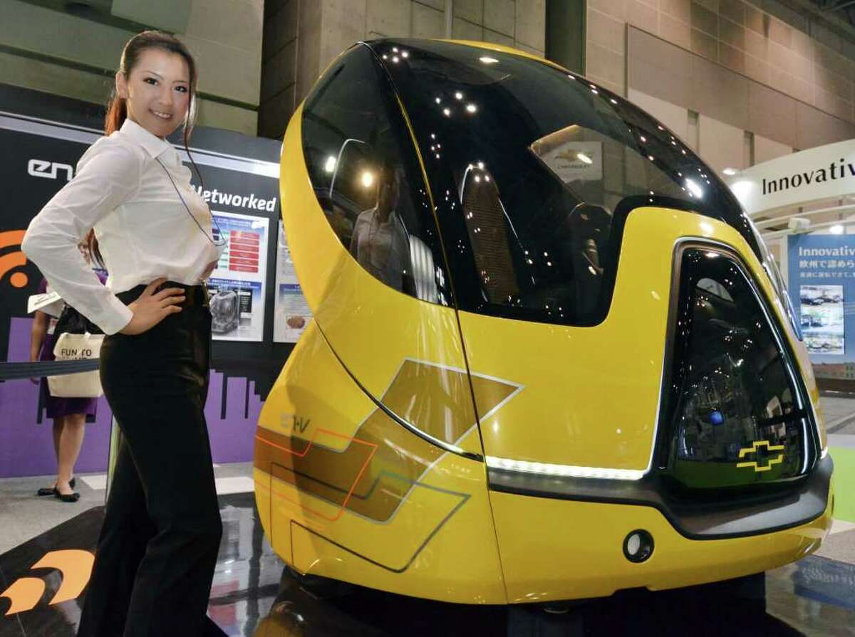 A model displays a concept electric vehicle by US auto giant General Motors called the
