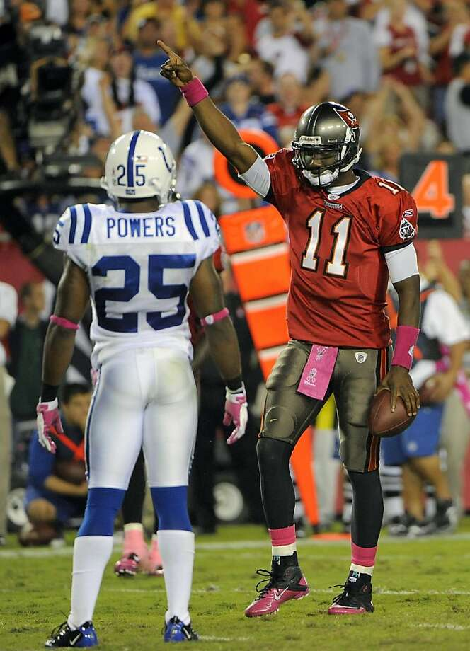 Indianapolis Colts cornerback Jerraud Powers (25) looks on as Tampa Bay Buccaneers quarterback Josh Johnson (11) celebrates running for a first down during an NFL football game on Monday, Oct. 3, 2011, in Tampa, Fla. (AP Photo/Brian Blanco) Photo: Brian Blanco, AP