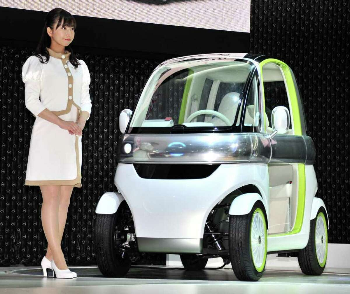 Japan's auto maker Daihatsu, Toyota's small car affiliation, displays the company's concept model two-seater electric personal mobility vehicle called the