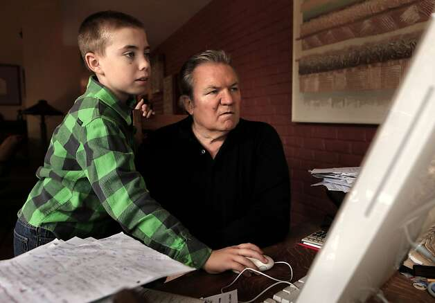Ralph Barbieri is guided around the internet by his 11-year-old son, Tate at their Novato, Ca. home, Ca. on Saturday October 1, 2011. Photo: Michael Macor, The Chronicle