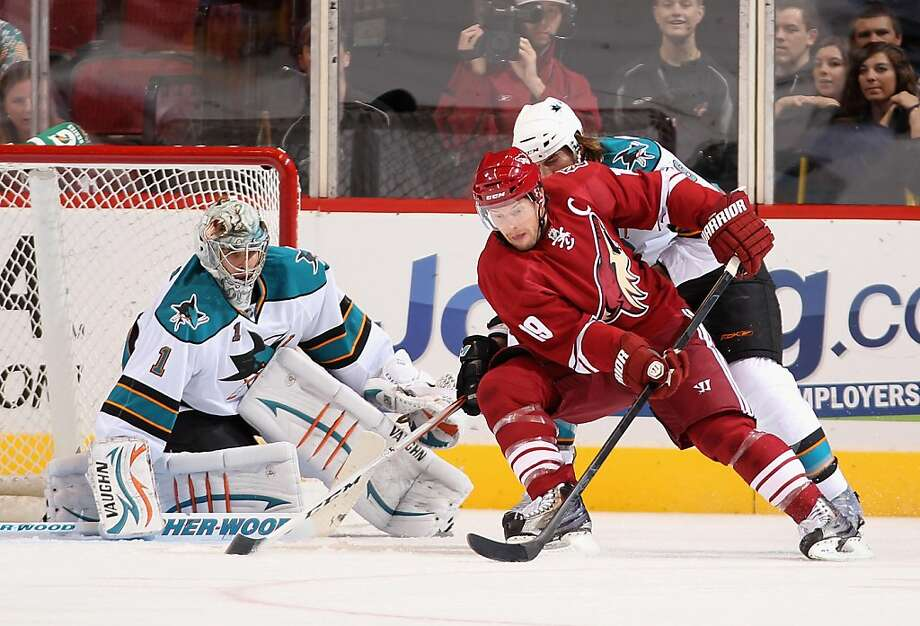 GLENDALE, AZ - OCTOBER 01:  Shane Doan #19 of the Phoenix Coyotes attempts a wrap around shot on goaltender Thomas Greiss #1 of the San Jose Sharks during the preseason NHL game at Jobing.com Arena on October 1, 2011 in Glendale, Arizona.  (Photo by Christian Petersen/Getty Images) Photo: Christian Petersen, Getty Images