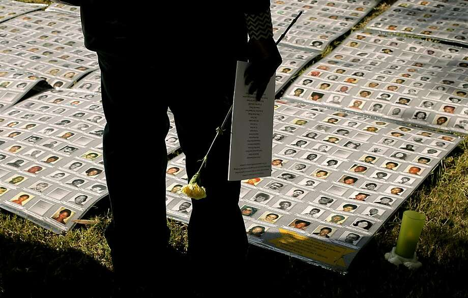 Photos of the victims on display as family and friends gather for the 32nd anniversary of the Jonestown massacre, on Thursday Nov. 18, 2010 at the Evergreen Cemetery in Oakland, Calif.,to remember those lost in the mass suicide in Guyana, South America in 1978.  Ran on: 11-19-2010 Photos of some of the 918 killed in the 1978 Jonestown suicide are displayed at Evergreen Cemetery in Oakland. Ran on: 11-19-2010 Photos of some of the 918 killed in the 1978 Jonestown suicide are displayed at Evergreen Cemetery in Oakland. Photo: Michael Macor, The Chronicle
