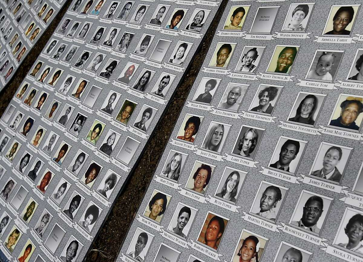 Pictures of many who perished at Jonestown were on display near the new memorial. A permanent memorial to those who perished at Jonestown, Guyana was unveiled Sunday May 30, 2011 at Evergreen Cemetery in Oakland, Calif.