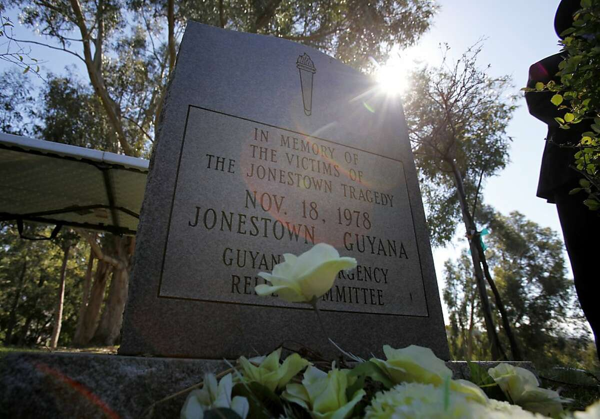 A gravestone marks the place where a mass grave contains the remains of 400 from Jonestown. Jonestown survivors and supporters gathered at Evergreen Cemetery Monday February 28, 2011 in Oakland, Calif., to protest the cemetery's decision to put together a memorial including the name of cult leader Jim Jones. Ran on: 03-01-2011 Photo caption Dummy text goes here. Dummy text goes here. Dummy text goes here. Dummy text goes here. Dummy text goes here. Dummy text goes here. Dummy text goes here. Dummy text goes here.###Photo: jonestown01_PH21298764800SFC###Live Caption:A gravestone marks the place where a mass grave contains the remains of 400 from Jonestown. Jonestown survivors and supporters gathered at Evergreen Cemetery Monday February 28, 2011 in Oakland, Calif., to protest the cemetery's decision to put together a memorial including the name of cult leader Jim Jones.###Caption History:A gravestone marks the place where a mass grave contains the remains of 400 from Jonestown. Jonestown survivors and supporters gathered at Evergreen Cemetery Monday February 28, 2011 in Oakland, Calif., to protest the cemetery's decision to put together a memorial including the name of cult leader Jim Jones.###Notes:Brant Ward, 415.606.3744###Special Instructions:**MANDATORY CREDIT FOR PHOTOG AND SF CHRONICLE-NO SALES-MAGS OUT-TV OUT-INTERNET: AP MEMBER NEWSPAPERS ONLY**