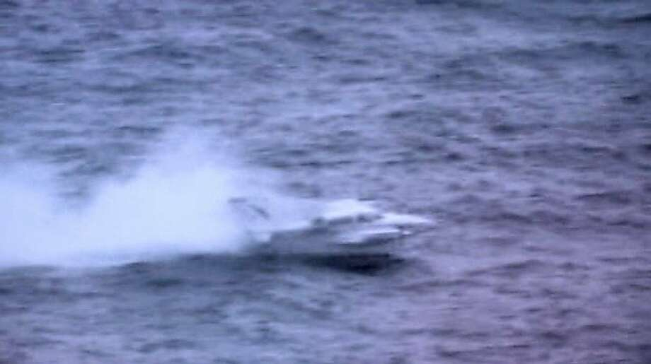In this image made from video made available by the U.S. Coast Guard, a small plane which had run out of fuel lands in the ocean several miles off Hawaii's coast on Friday, Oct. 7, 2011. The pilot was rescued by Coast Guard crews who had flown alongside and coached him on crash landing in the choppy seas. The 65-year-old man, who was not seriously injured, was flying solo from Monterey, Calif., when he radioed authorities Friday afternoon that he was running low on fuel about 500 miles from his destination of Hilo, Hawaii, the Coast Guard said. The cities are about 2,300 miles apart. (AP Photo/U.S. Coast Guard) Ran on: 10-09-2011 This twin-engine plane, piloted by a 65-year-old man, runs out of fuel on the solo flight from Monterey and crash lands in the ocean 13 miles off Hawaii. Photo: U.S. Coast Guard, AP