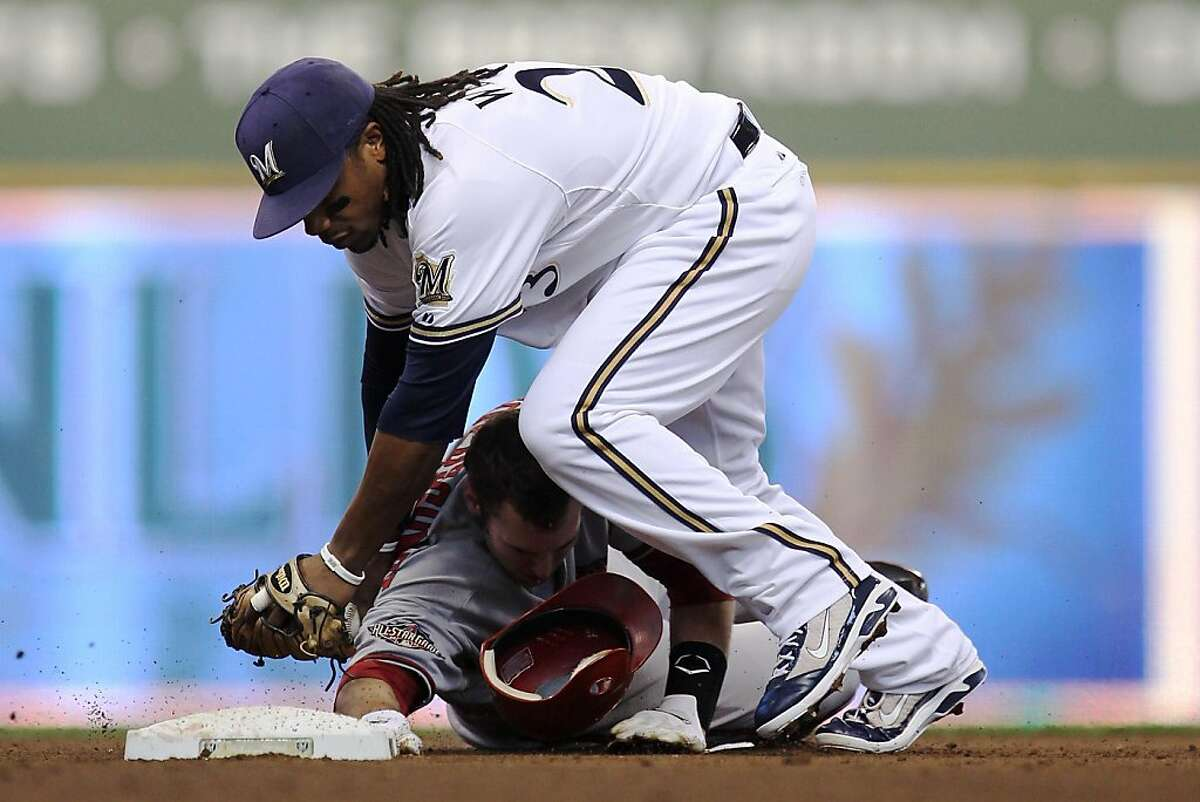 MILWAUKEE, WI - OCTOBER 07: Second baseman Rickie Weeks #23 of the Milwaukee Brewers tags out Paul Goldschmidt #44 of the Arizona Diamondbacks on a fielder's choice hit by Chris Young #24 in the fourth inning in Game Five of the National League Division Series at Miller Park on October 7, 2011 in Milwaukee, Wisconsin. (Photo by Jonathan Daniel/Getty Images)