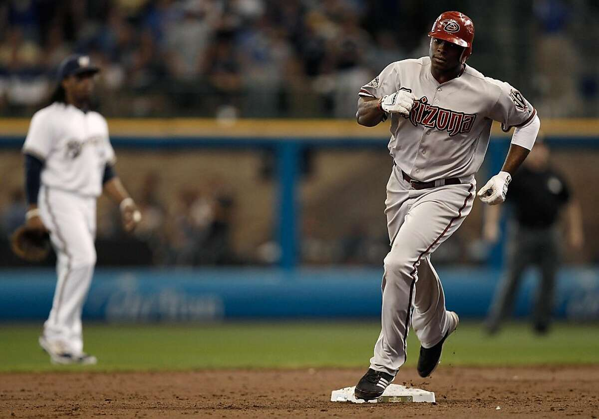 MILWAUKEE, WI - OCTOBER 07: Justin Upton #10 of the Arizona Diamondbacks trots around second base after hitting a solo home run in the third inning against the Milwaukee Brewers during Game Five of the National League Division Series at Miller Park on October 7, 2011 in Milwaukee, Wisconsin. (Photo by Jared Wickerham/Getty Images)