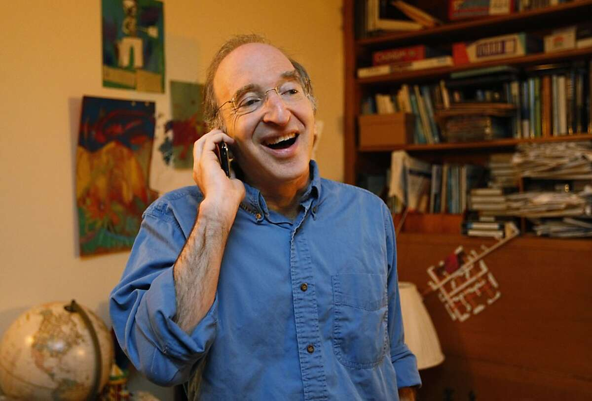 Nobel Prizes winner for physics Saul Perlmutter smiles as he receives the official phone call from the Royal Swedish Academy at his home in Berkeley, Calif., Tuesday, Oct. 4, 2011 that he had won. The Royal Swedish Academy of Sciences said American Perlmutter would share the 10 million kronor ($1.5 million) award with U.S.-Australian Brian Schmidt and U.S. scientist Adam Riess. Working in two separate research teams during the 1990s, Perlmutter in one and Schmidt and Riess in the other, the scientists raced to map the universe's expansion by analyzing a particular type of supernovas, or exploding stars. (AP Photo/Paul Sakuma)