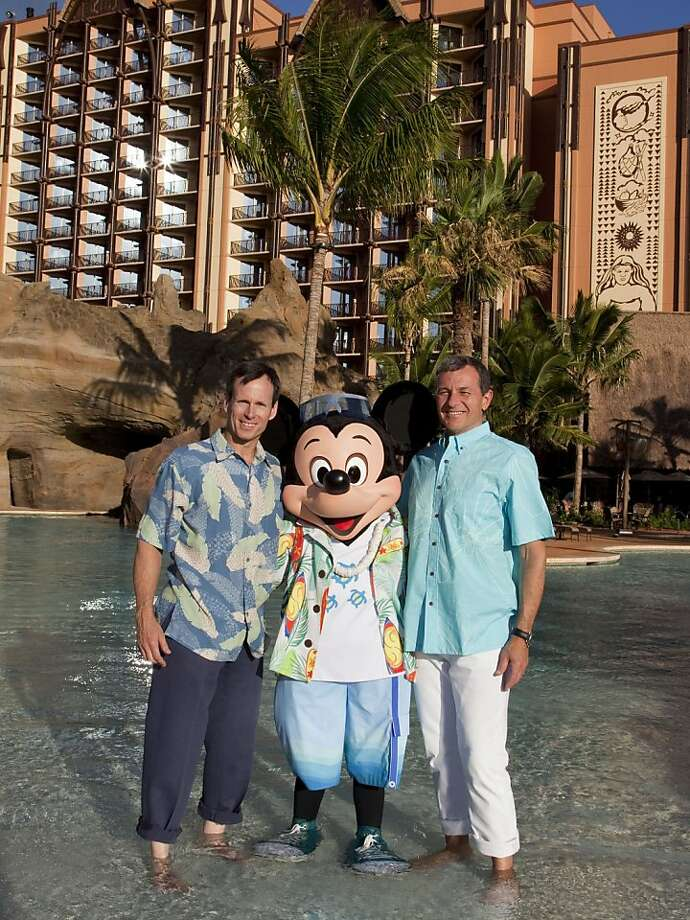 OAHU, HI - SEPTEMBER 21:  Bob Iger, President and CEO, The Walt Disney Company (R) and Tom Staggs, Chairman, Walt Disney Parks and Resorts, are joined by Mickey Mouse as final preparations are made for the grand opening celebration of Aulani, a new Disney Resort & Spa in Hawaii on September 21, 2011 in Oahu, Hawaii. With its fun recreation features and restaurants, comfortable rooms, and its combination of Disney magic with Hawaiian beauty, tradition and relaxation, Aulani offers a new way for families to vacation together on the island of Oahu. (Photo by Paul Hiffmeyer/Disney Parks via Getty Images) Photo: Handout, Getty Images