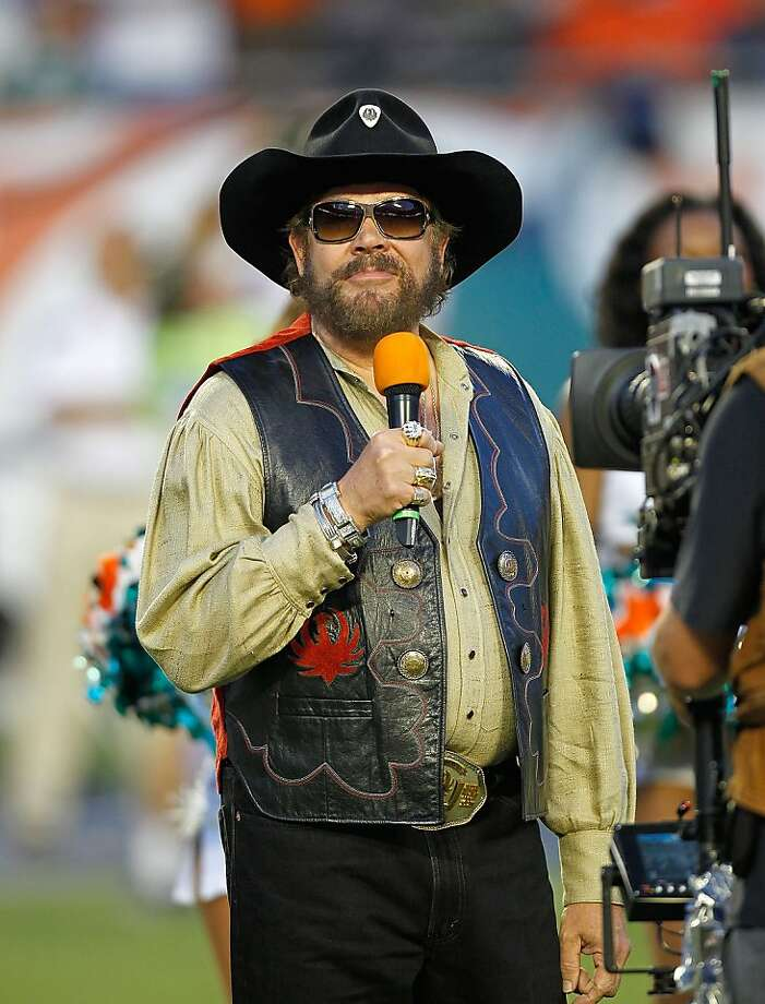 MIAMI GARDENS, FL - SEPTEMBER 12: Country singer Hank Williams JR greets the crowd during a game between the Miami Dolphins and the New England Patriots at Sun Life Stadium on September 12, 2011 in Miami Gardens, Florida.  (Photo by Mike Ehrmann/Getty Images) Photo: Mike Ehrmann, Getty Images