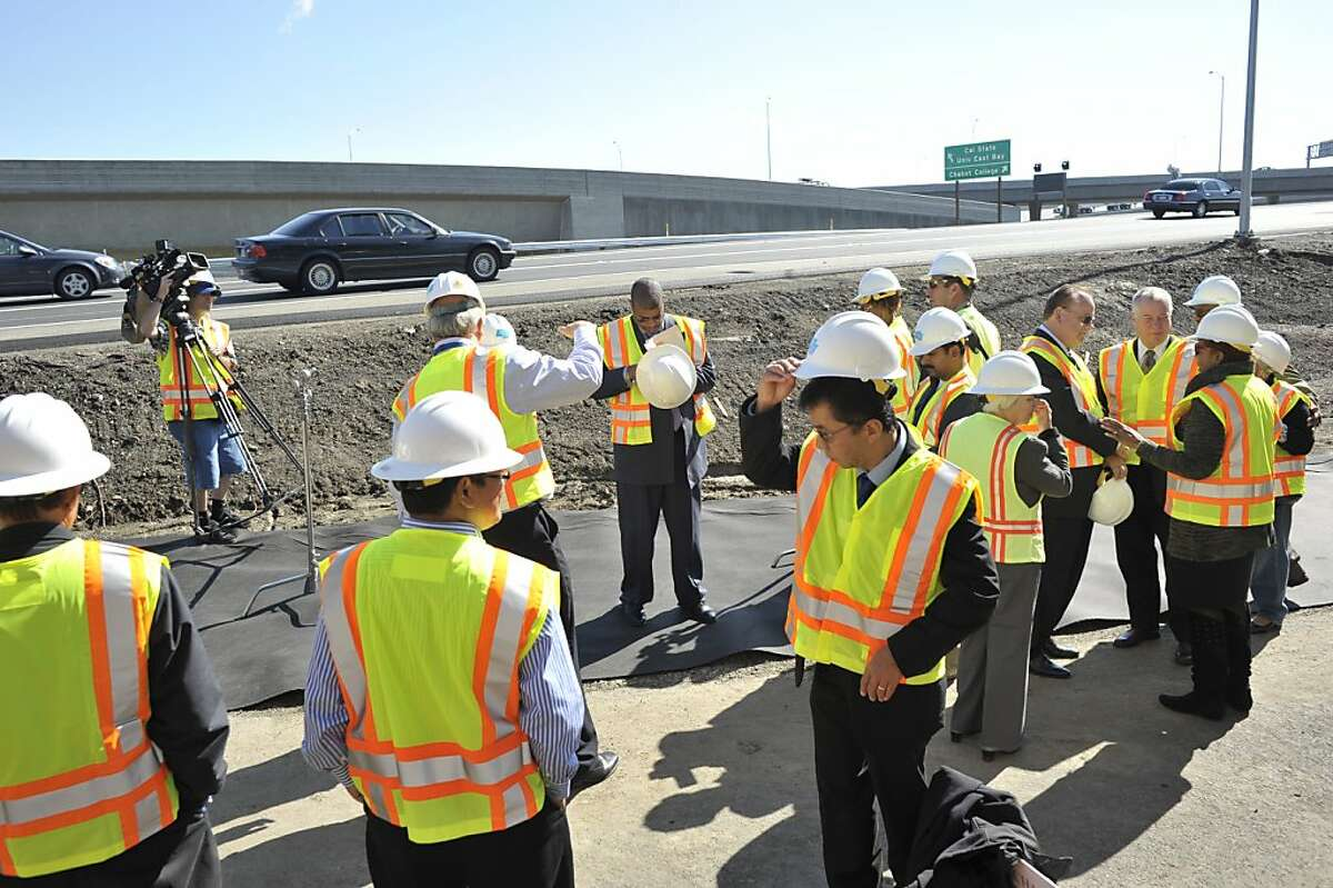 Dignitaries and CalTrans officials prepare for a ceremony for the completion of a nearly two-decades project to smooth traffic flow at the 880/92 interchange in Hayward. Ran on: 10-08-2011 Officials gather for a dedication ceremony at the new Highway 92-Interstate 880 interchange.