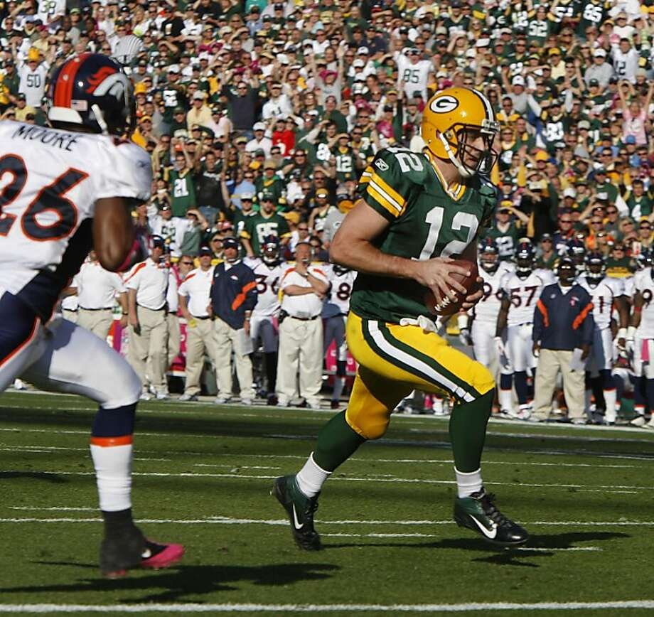 Green Bay Packers Aaron Rogers runs for a touchdown against the Denver Broncos at Lambeau Field in Green Bay, Wisconsin, Sunday, October 2, 2011. Packers Morgan Burnett recovered the ball. The Packers defeated the Broncos, 49-23. (Rick Wood/Milwaukee Journal Sentinel/MCT) Photo: Rick Wood, MCT