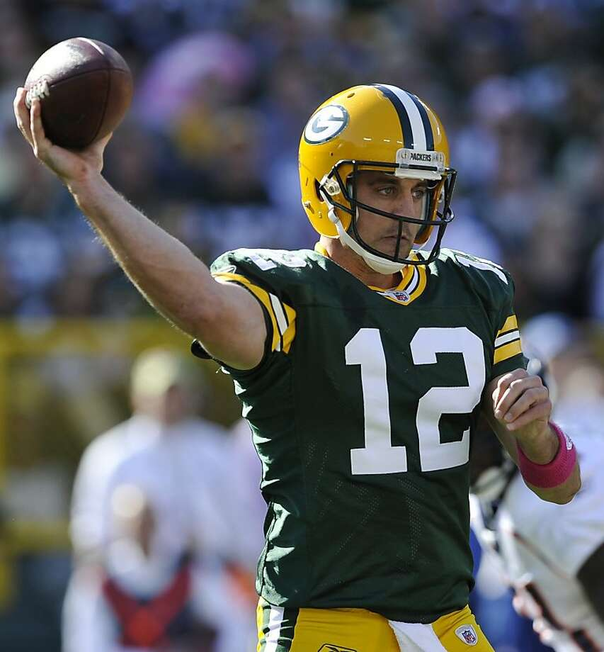 Green Bay Packers quarterback Aaron Rodgers (12) throws a pass during the first half of an NFL football game against the Denver Broncos, Sunday, Oct. 2, 2011, in Green Bay, Wis. (AP Photo/Jim Prisching) Photo: Jim Prisching, AP