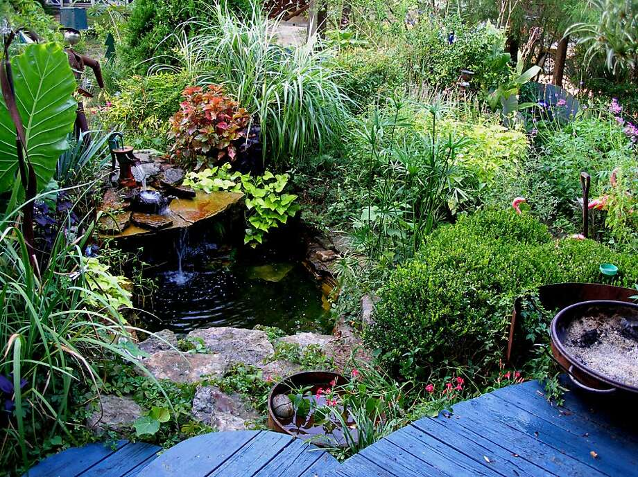 Slow Gardening 0813  The fountain in author Felder Rushing's garden is small, but its sound blocks city noises and makes his garden even more relaxing.   Credit: Felder Rushing Photo: Felder Rushing