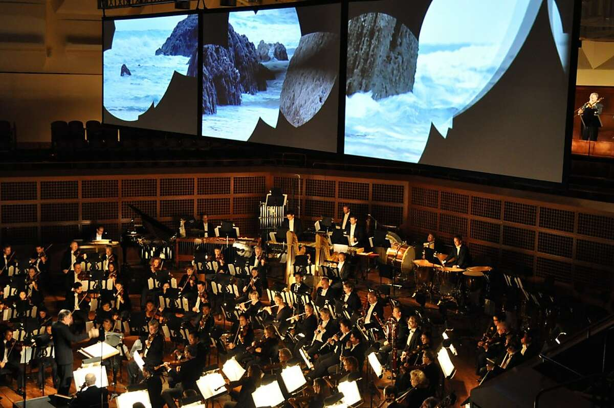 Michael Tilson Thomas conducts the SF Symphony in Thomas Ades' Polaris, with video by Tal Rosner, 9/29/11. Davies Symphony Hall.