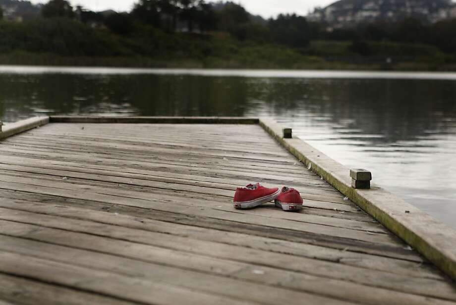 A pair of shoes are abandoned on a dock on Lake Merced on Saturday, June 4, 2011, in San Francisco, Calif. Photo: Michelle Terris, The Chronicle