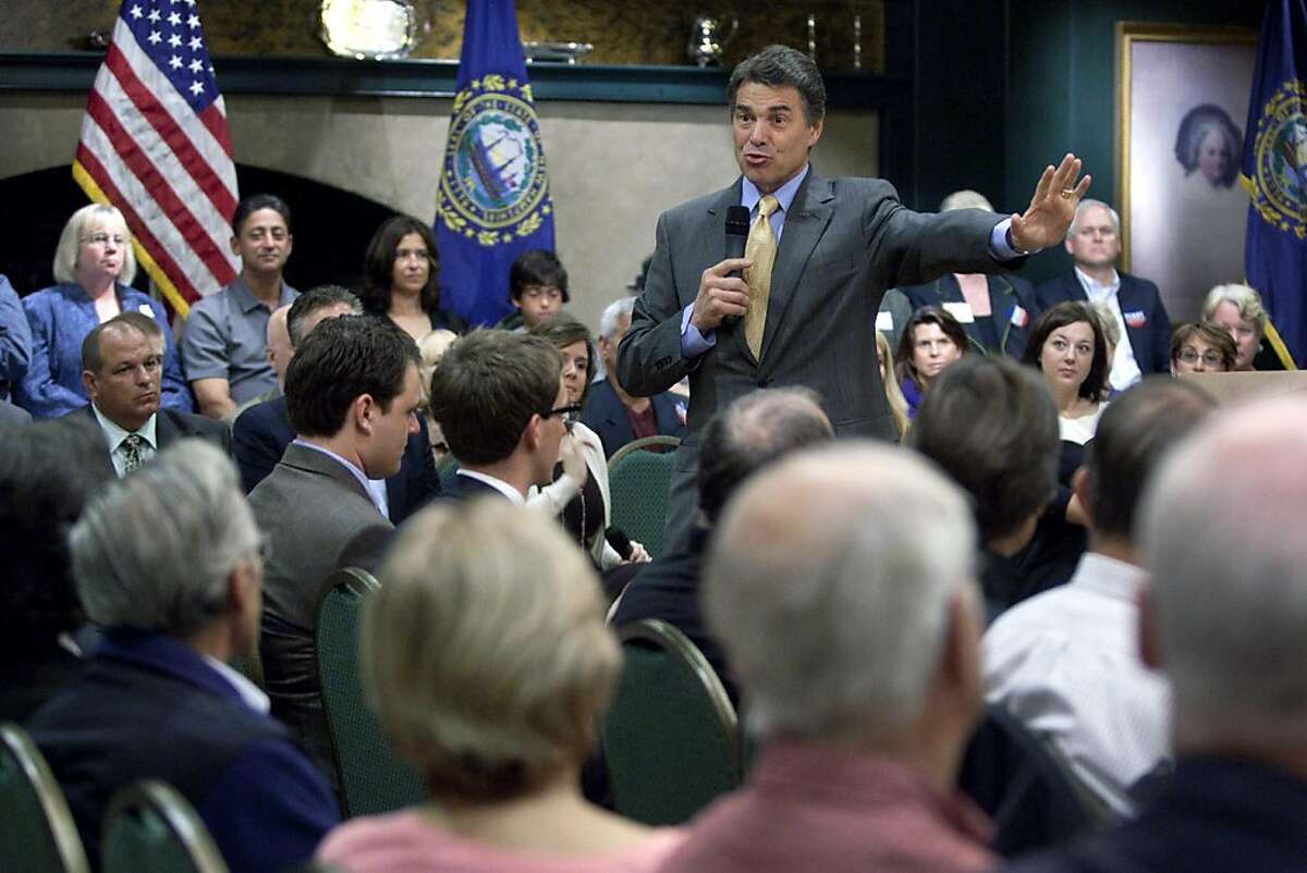 HAMPTON, NH - OCTOBER 1: Republican presidential candidate, Texas Gov. Rick Perry speaks to local residents at the