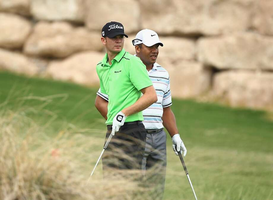 LAS VEGAS, NV - SEPTEMBER 30:  Brendan Steele (L) and Jhonattan Vegas (R) of Venezuela watch a shot on the 17th hole during the second round of the Justin Timberlake Shriners Hospitals for Children Open at the TPC Summerlin on September 30, 2011 in Las Vegas, Nevada.  (Photo by Scott Halleran/Getty Images) Photo: Scott Halleran, Getty Images