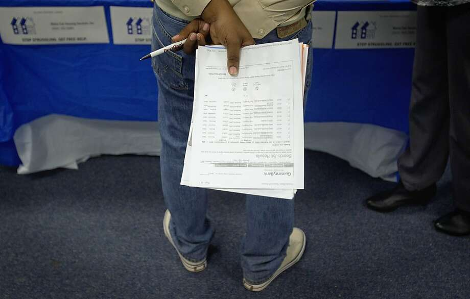 In this Oct. 4, 2011 photo, a job seeker holds a list of employment openings while talking with a recruiter during a job fair at a Goodwiill store, in Atlanta. The number of people who applied for unemployment benefits rose slightly last week, a sign that the job market remains weak. (AP Photo/David Goldman) Photo: David Goldman, AP