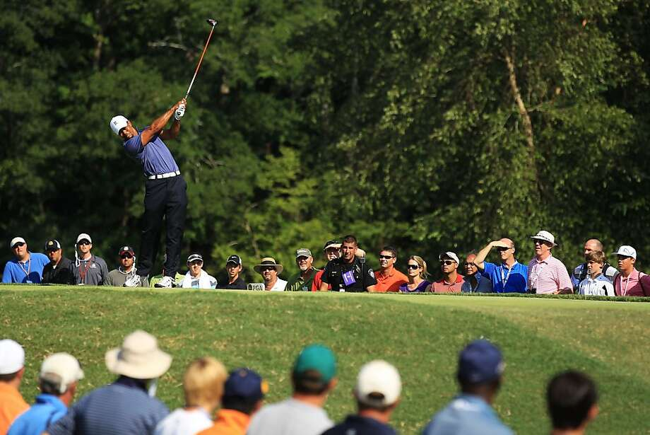 JOHNS CREEK, GA - AUGUST 12:  Tiger Woods hits his tee shot on the 14th hole during the second round of the 93rd PGA Championship at the Atlanta Athletic Club on August 12, 2011 in Johns Creek, Georgia.  (Photo by David Cannon/Getty Images) Photo: David Cannon, Getty Images