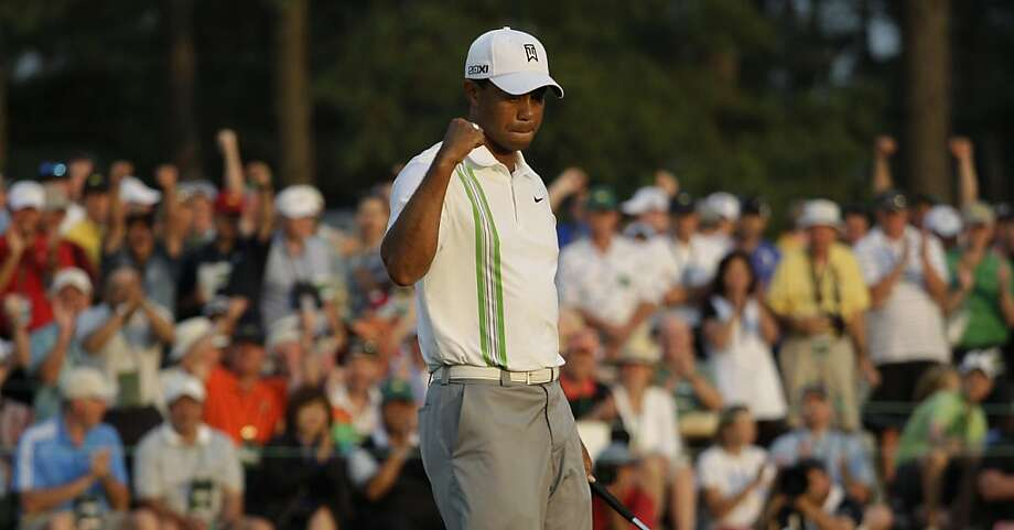 Tiger Woods pumps his fist after a birdie on the 18th hole during the second round of the Masters golf tournament Friday, April 8, 2011, in Augusta, Ga. (AP Photo/Charlie Riedel)  Ran on: 04-09-2011 Tiger Woods played his final 11 holes Friday in 7-under par. Ran on: 04-09-2011 Tiger Woods played his final 11 holes Friday in 7-under par. Photo: Charlie Riedel, AP