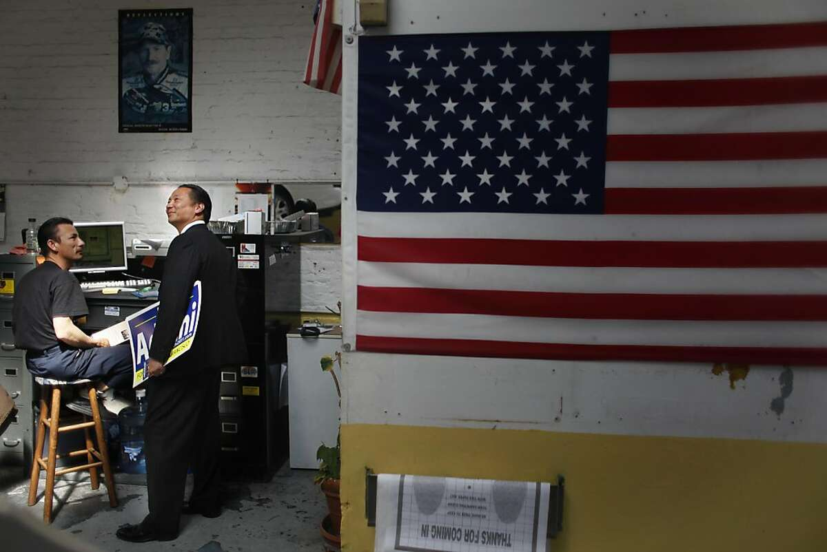 San Francisco Public Defender and San Francisco mayoral candidate Jeff Adachi (right) talks with Lam Nguyn (left), mechanic JQ Autotech while on a merchant walk on Polk Street in San Francisco, Calif., on Tuesday, September 20, 2011.