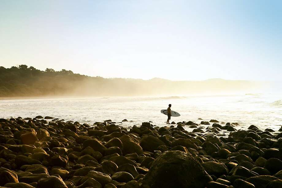 Surf For Life El Salvador: Alex Fang heads out for a surf at Punta Mango, near El Cuco, El Salvador. Photo: Erin Kunkel, © Erin Kunkel.
