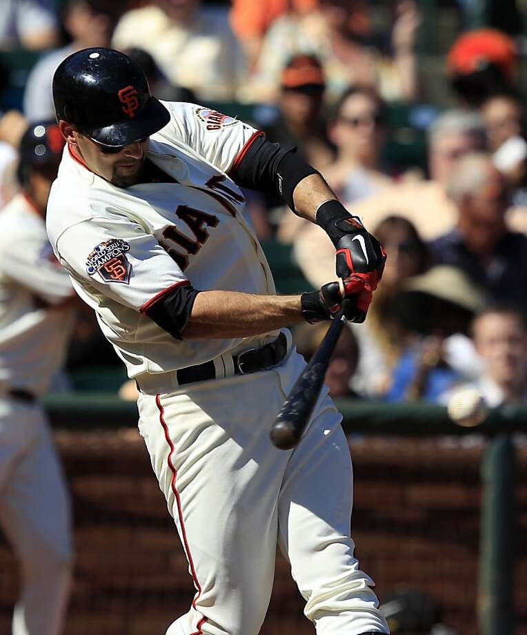 San Francisco Giants' Mark DeRosa drives in two runs with a single against the Colorado Rockies during the sixth inning of a baseball game in San Francisco, Wednesday, Sept. 28, 2011. (AP Photo/Marcio Jose Sanchez) Photo: Marcio Jose Sanchez, AP