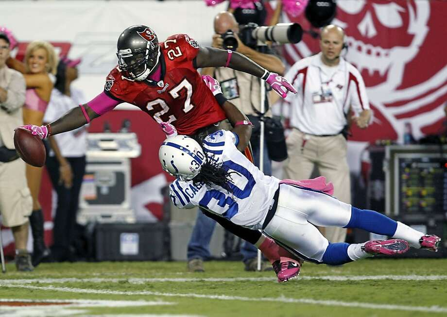 Tampa Bay Buccaneers running back LeGarrette Blount (27) dives in the end zone to score the winning touchdown on a 35-yard run past Indianapolis Colts safety David Caldwell (30) during the second half of an NFL football game, Tuesday, Oct. 4, 2011, in Tampa, Fla. The Buccaneers defeated the Colts 24-17. (AP Photo/Margaret Bowles) Photo: Margaret Bowles, AP