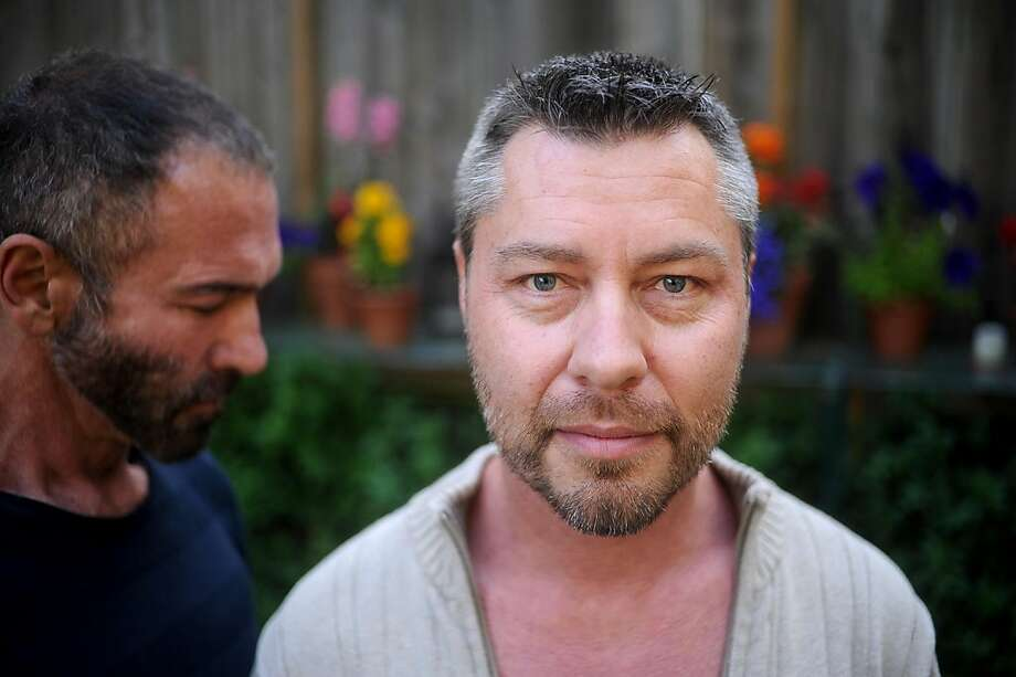Anthony Makk, right, spends time with husband Bradford Wells on Monday, Aug. 8, 2011, at their San Francisco home. Though legally married in 2004, Makk faces deportation back to his native Australia. Photo: Noah Berger, Special To The Chronicle