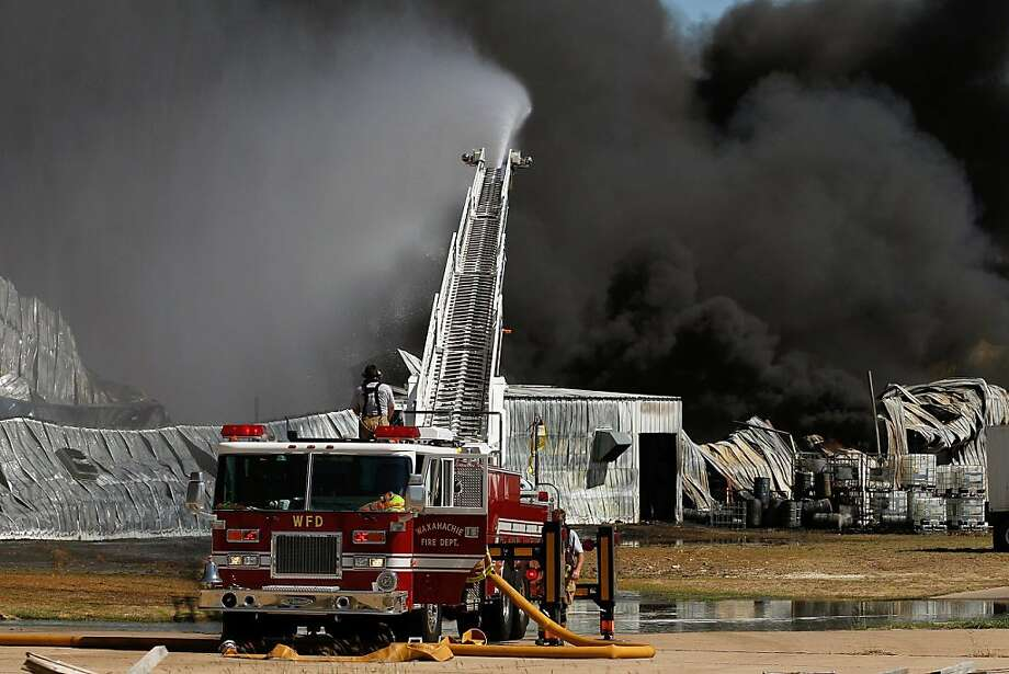 WAXAHACHIE, TX - OCTOBER 03:  Waxahachie firefighters battle a massive fire at the Magnablend chemical processing plant on October 3, 2011 in Waxahachie, Texas. The burning chemical plant is not far from several residential areas and Wedgeworth Elementary School.  (Photo by Tom Pennington/Getty Images) Photo: Tom Pennington, Getty Images