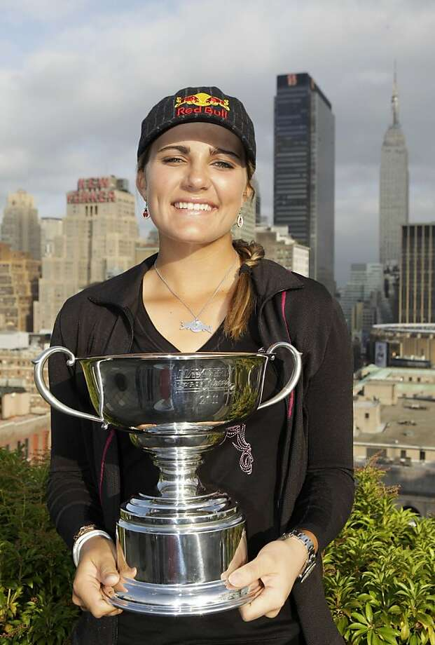 Golfer Lexi Thompson, 16, who on Sunday became the youngest player to win an LPGA tournament, poses with her trophy in New York, Tuesday, Sept. 20, 2011.  Thompson, of Coral Springs, Fla., shattered the age record for winning a multiple-round tournament when she won the Navistar LPGA Classic golf tournament on Sunday in Alabama. (AP Photo/Kathy Willens) Photo: Kathy Willens, AP
