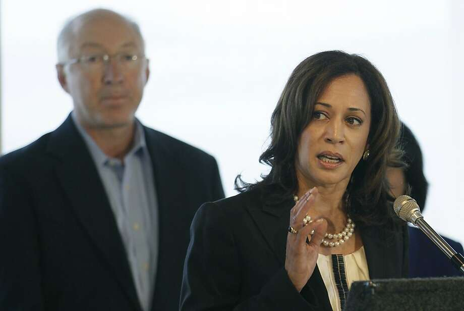 California Attorney General Kamala Harris, right, speaks in front of U.S. Interior Secretary Ken Salazar, left, at a news conference in Treasure Island, Calif., Monday, Sept. 19, 2011. The companies responsible for the 2007 oil spill in San Francisco Bay have agreed to pay the government $44.4 million for the cleanup costs. Salazar, Harris and other officials announced the proposed deal Monday. It would settle several lawsuits filed against Hong Kong-based Fleet Management Ltd. and Regal Stone Ltd. (AP Photo/Jeff Chiu) Photo: Jeff Chiu, AP