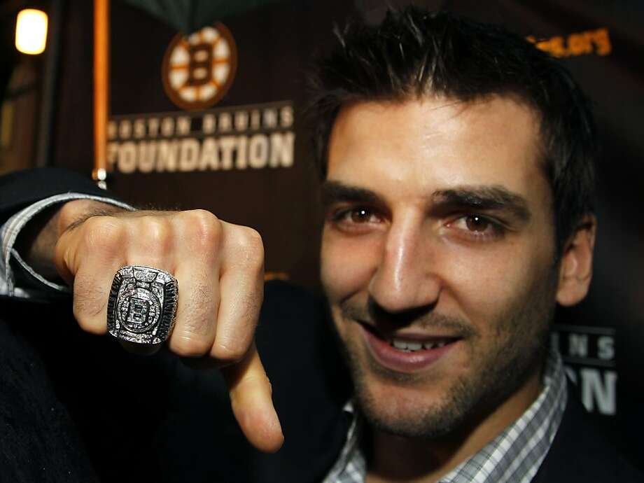 Boston Bruins NHL hockey forward Patrice Bergeron displays his Stanley Cup Championship ring to members of the media outside the Boston Harbor Hotel, in Boston, Tuesday, Oct. 4, 2011, following the unveiling of the rings during ceremonies for the hockey team. (AP Photo/Steven Senne) Photo: Steven Senne, AP