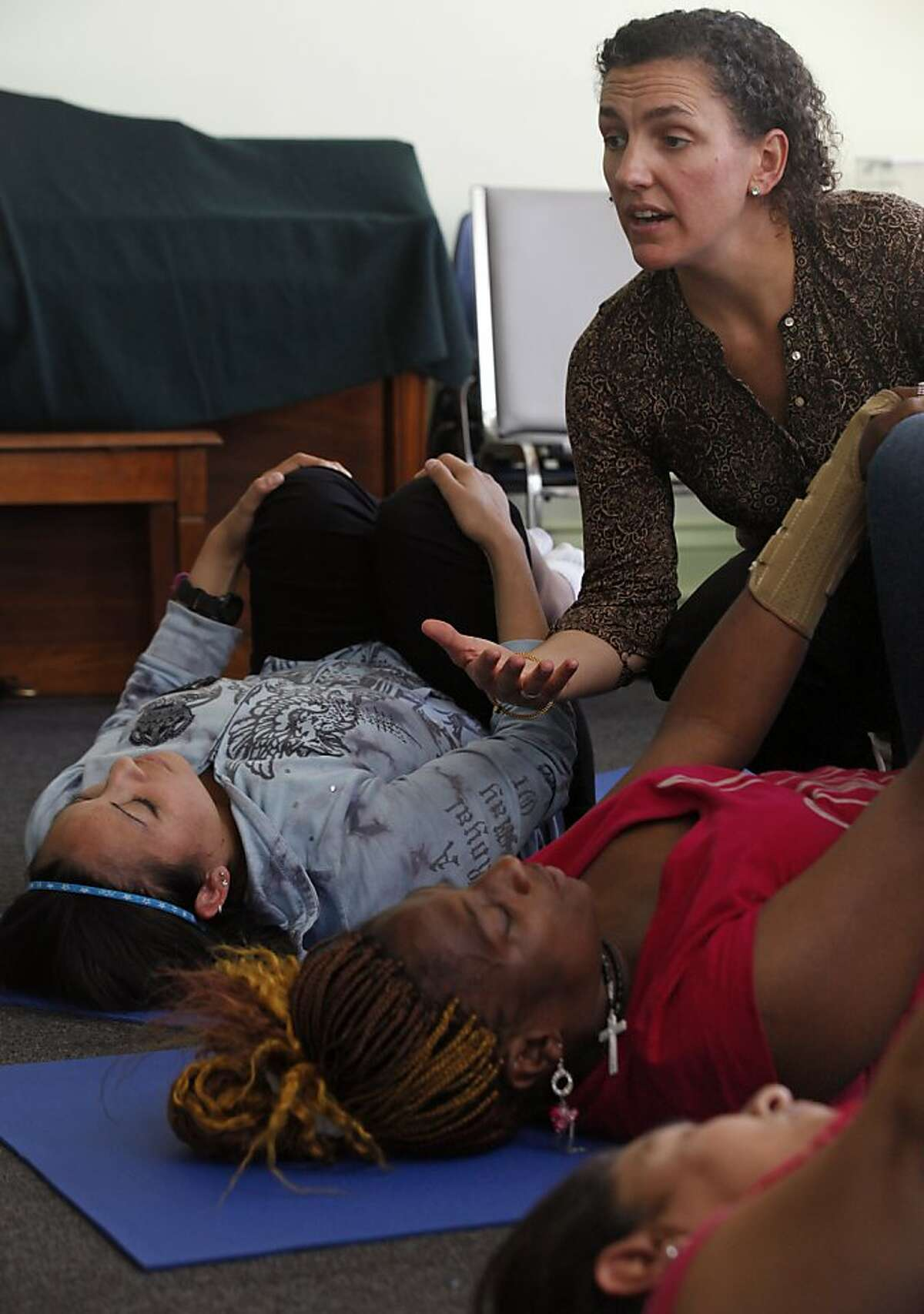 Kate Holcombe, founder of the Healing Yoga Foundation leads a class for Compass Family Services with a group of homeless mothers Wednesday September 21, 2011 in San Francisco.