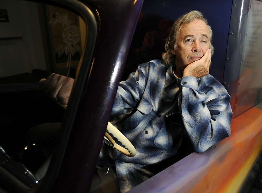 Musician Ry Cooder poses alongside a custom-built ice cream truck commissioned by him and featuring a mural of Los Angeles' Chavez Ravine by artist Vincent Valdez, at the Petersen Automotive Museum in Los Angeles, Thursday, July 10, 2008. (AP Photo/Chris Pizzello)  Ran on: 10-02-2011 Ry Cooder Ran on: 10-02-2011 Ry Cooder Photo: Chris Pizzello, AP 2008