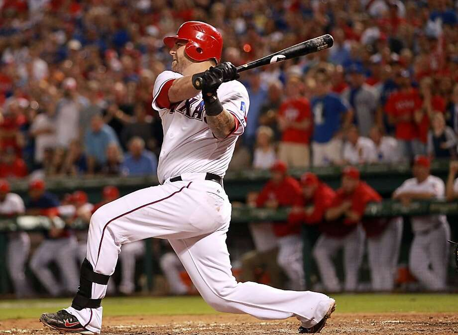 ARLINGTON, TX - OCTOBER 01:  Mike Napoli #25 of the Texas Rangers hits a two-run single against the Tampa Bay Rays in the 4th inning during Game Two of the American League Division Series at Rangers Ballpark in Arlington on September 30, 2011 in Arlington, Texas.  (Photo by Ronald Martinez/Getty Images) Photo: Ronald Martinez, Getty Images