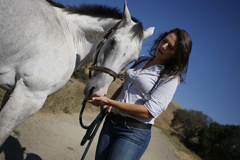 Alana Alpern, an equine veterinarian, is seen with her horse Ziggy in Castro Valley, Calif. on Friday, Sept. 9, 2011.  Alpern integrates western advances in veterinary medicine with traditional eastern philosophy at her practice, Blue Heron Veterinary. Photo: Dylan Entelis, The Chronicle