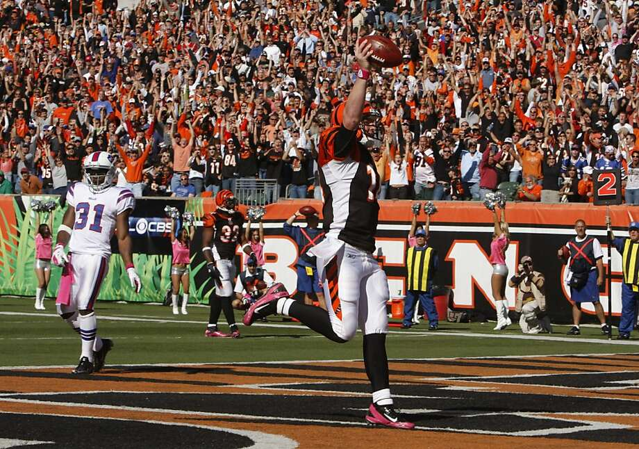 Cincinnati Bengals quarterback Andy Dalton (14) scores a touchdown on a three-yard run past Buffalo Bills safety Jairus Byrd (31) in the second half of an NFL football game, Sunday, Oct. 2, 2011, in Cincinnati. Cincinnati won 23-20. (AP Photo/David Kohl) Photo: David Kohl, AP