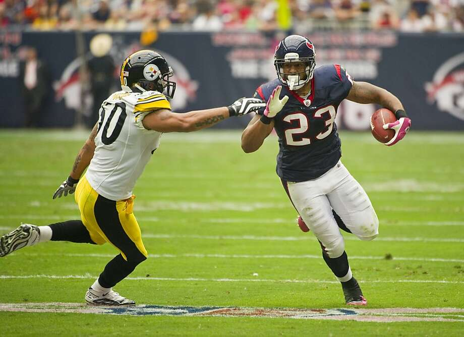 Houston Texans' Arian Foster (23) rushes against Pittsburgh Steelers' Larry Foote, left, during the first quarter of an NFL football game Sunday, Oct. 2, 2011, in Houston. (AP Photo/Dave Einsel) Photo: Dave Einsel, AP