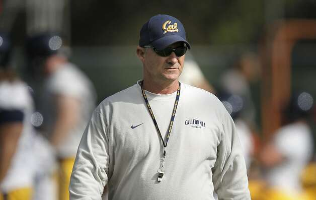 Head coach Jeff Tedford keeps a close watch during practice, as the UC California Bears open their fall training camp in Berkeley, Ca. on Saturday August 6, 2011.  Ran on: 08-10-2011 Cal head coach Jeff Tedford observed the action during the first day of training camp Saturday. Several freshmen already have made an impression. Photo: Michael Macor, The Chronicle
