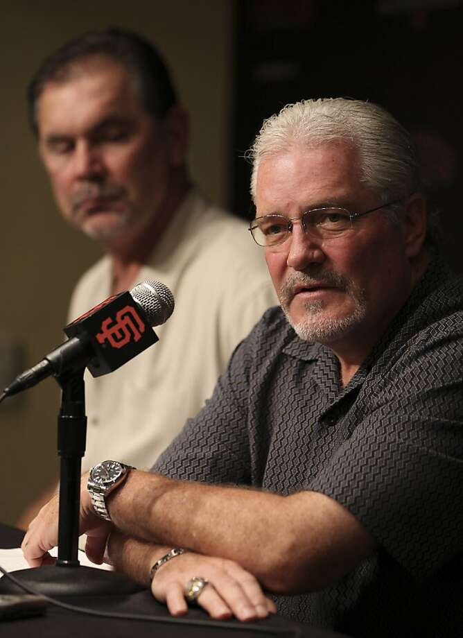 San Francisco Giants general manager Brian Sabean, right, and manager Bruce Bochy field questions from the media during a news conference Thursday, Sept. 29, 2011, in San Francisco. The reigning World Series champions are headed home early this year after high hopes of another special postseason run.(AP Photo/Ben Margot) Photo: Ben Margot, AP