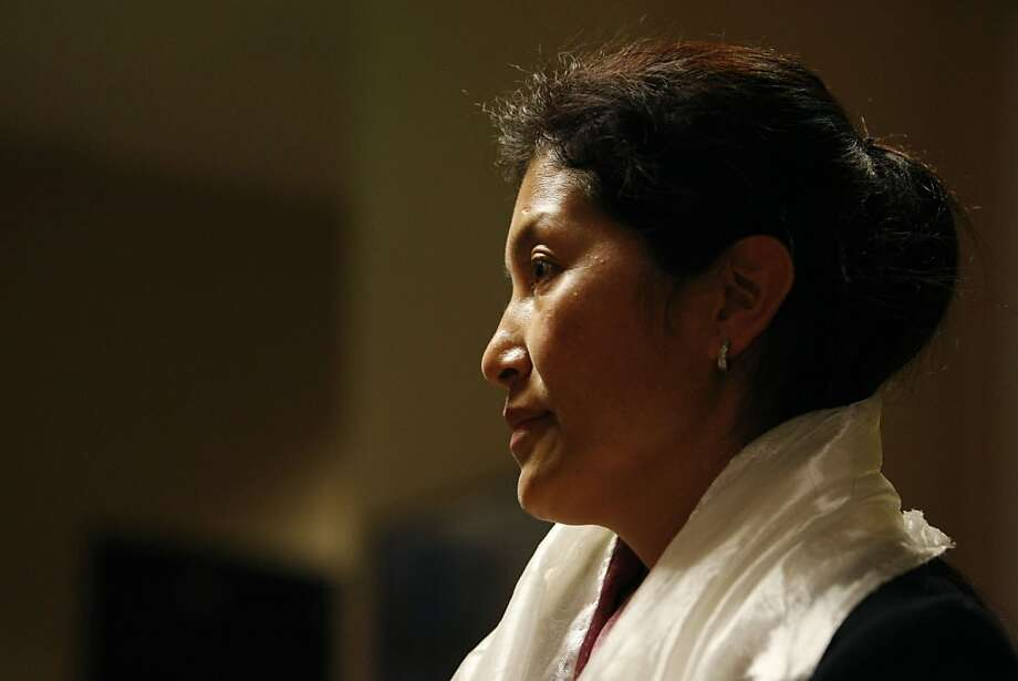 The former Tibetan Buddhist Nun Ngawang Sangdrol stands after a question and answer session at Amnesty International in San Francisco Calif, on Wednesday, March 9, 2011. She is believed to be China's longest serving female prisoner of conscience and says she sometimes dreams as if she is still being held captive. Photo: Alex Washburn, The Chronicle