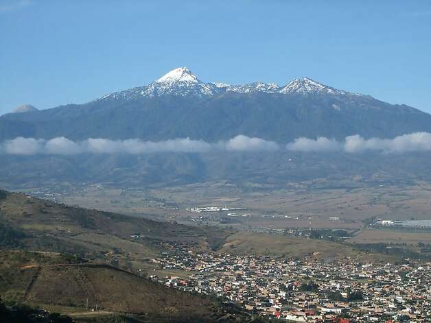 Ciudad Guzman, Jalisco, Mexico -- The dormant volcano Nevado de Colima looms over the city. Entrance to the national park Nevado shares with sporadically active Volcan de Fuego is a few minutes from Guzman. Photo credit: Paul Roberts  ONE-TIME USE ONLY; CONTACT PHOTOGRAPHER FOR REUSE Photo: Paul Roberts