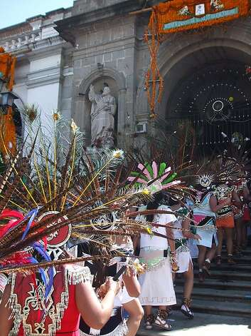 Ciudad Guzman, Jalisco, Mexico  -- Aztec dancers enter the colonial cathedral. Photo credit: Paul Roberts  ONE-TIME USE ONLY; CONTACT PHOTOGRAPHER FOR REUSE Photo: Paul Roberts
