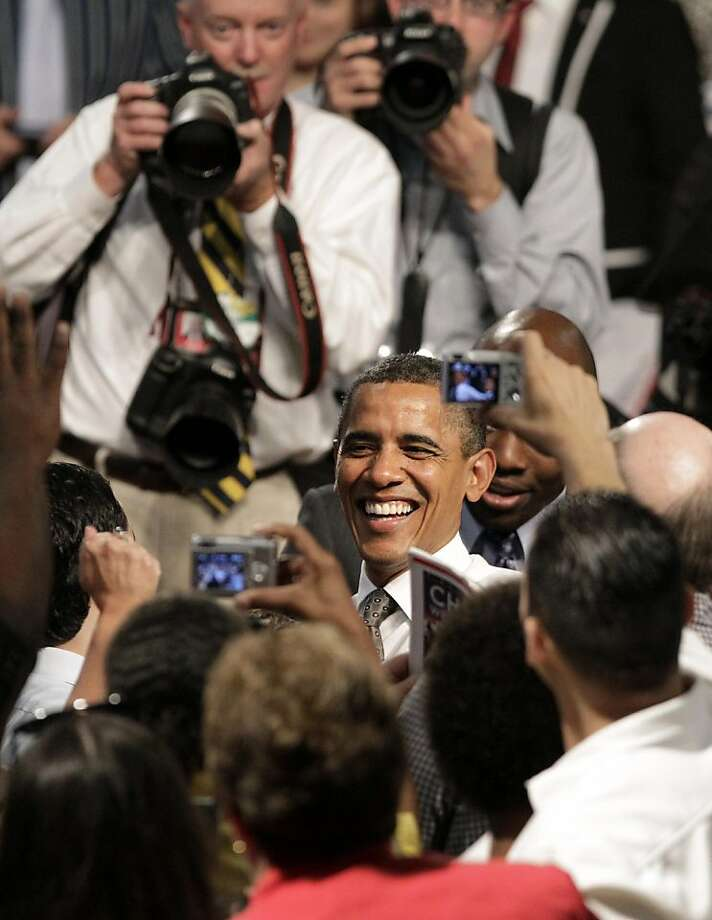 President Barack Obama laughs as he shakes hands and poses for photos after speaking about the American Jobs Act at Eastfield College Tuesday, Oct. 4, 2011, in Mesquite, Texas. (AP Photo/Tony Gutierrez) Photo: Tony Gutierrez, AP