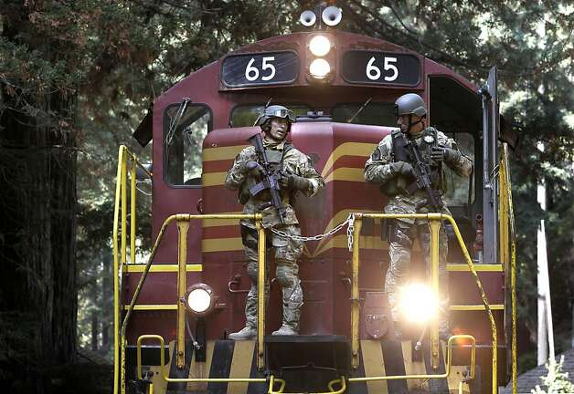 Sacramento Sheriff officers use the Skunk Train to access the search area, as law enforcement intensified their search for murder suspect Aaron Bassler a day after a shootout between police officers and the suspect in an unincorporated area of Mendocino County near Northspur, Ca. on Friday September 30, 2011. Photo: Michael Macor, The Chronicle