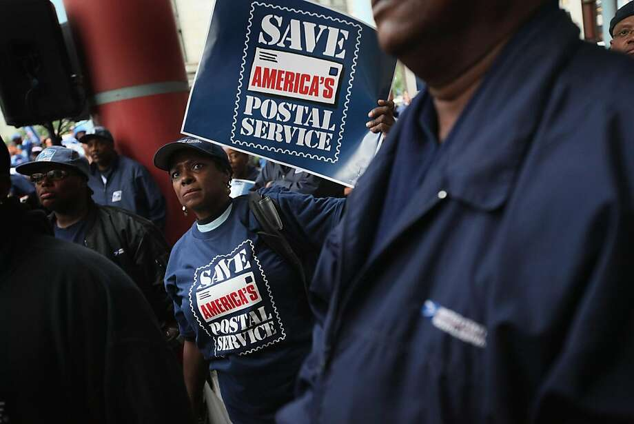CHICAGO, IL - SEPTEMBER 27:  Postal workers hold a rally outside the Thompson Center September 27, 2011 in Chicago, Illinois. The rally was one of many held nationwide by postal workers to try to gather support for H.R. 1351, a bill introduced in the House by Representative Stephen Lynch (D-MA) which the workers believe will prevent the closing of post offices, suspension of Saturday mail delivery and save up to 120,000 postal jobs.  (Photo by Scott Olson/Getty Images) Photo: Scott Olson, Getty Images