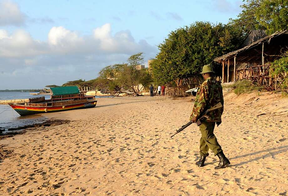"""A Kenyan policeman walks by the beach house of the kidnapped French woman on October 1, 2011 at Ras Gitau, in Manda, part of the Lamu archipelago. Somalia gunmen who snatched a disabled 66-year-old Frenchwoman from a Kenyan luxury resort island have re-entered Somalia after a shootout with Kenya's navy, officials said. The wheelchair-bound woman was taken from her home in Lamu at 3:30 am (0030 GMT) by """"10 heavily armed Somali bandits,"""" a government statement said, adding that the gunmen are """"suspected"""" of belonging to Somalia's Shebab Islamist rebels. AFP PHOTO/SIMON MAINA (Photo credit should read SIMON MAINA/AFP/Getty Images) Photo: Simon Maina, AFP/Getty Images"""